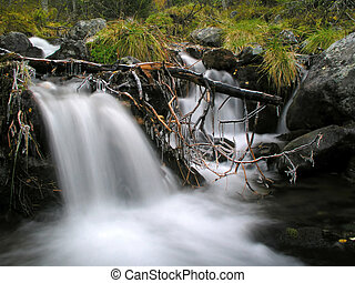 Waterfall in mountain - Flowing water from a small waterfall...