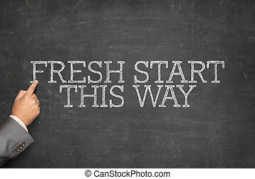 Fresh Start This Way text on blackboard with businessman...
