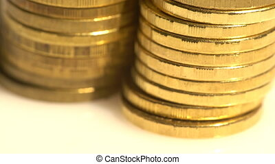 Closeup on golden coin piles - Macro view of shining golden...