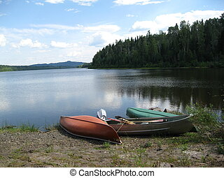 Canoes on the shore - Canoes docked at a lake, ready to go...