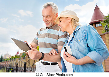 Aged couple enjoying each other - See the world. Happy and...