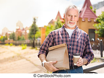 Aged man being outdoors - Young in heart one. Cheerful and...