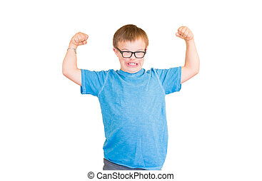 Boy With Downs Syndrome Flexing His Muscles - Young Boy With...