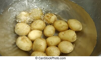 New potatoes lying in water. Fresh and clean potatoes....