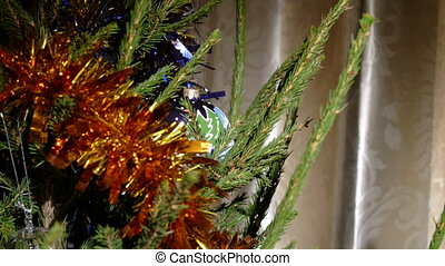An christmas tree with decoration - A down tilt on a...