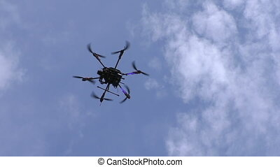 Drone flying in the sky - Hexacopter drone flying in the...