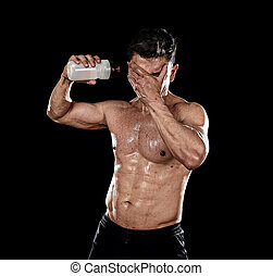 strong sport man pouring water on his face sweating after...