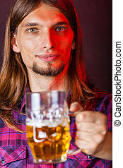 Man holds glass of beer - Alcohol liquor drinking party...