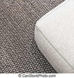 Soft seat on gray carpet - Close-up of a soft wool seat on...