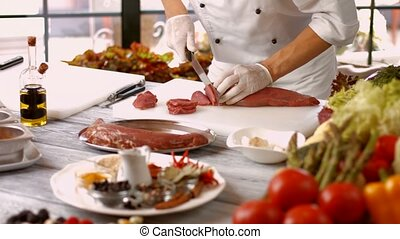Man cutting meat with knife.