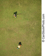 Gardeners bird view - Bird view of a two gardeners working...