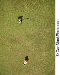 Gardeners bird view - Bird view of a two gardeners working...