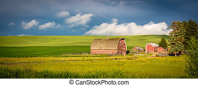 Red barn in farm country of Idaho - Rustic old red barn and...
