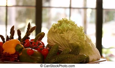 Chinese cabbage and red tomatoes. Vegetables on rotating...