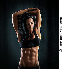 Muscular sexy woman - Muscular woman in a pose of stretching