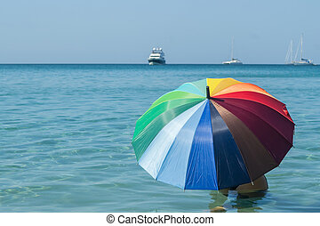 colorful umbrella with blue sky and sea background