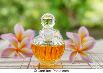 Aromatherapy essential oils in bottles on nature background