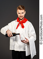 winemaking industry - Male sommelier tasting red wine....