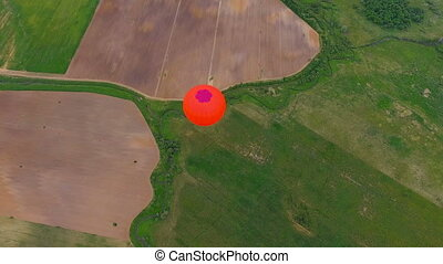 Hot air balloon in the sky over a field.Aerial view - Flying...