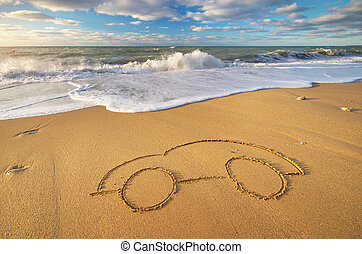 Draw car on beach sand.