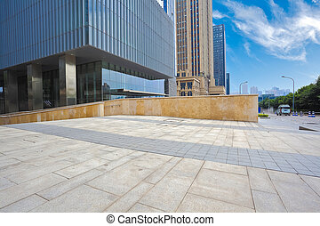 Empty road surface with modern office buildings background -...