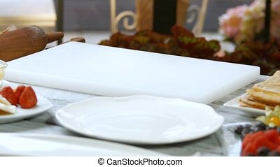 Hands put piece of cake Cake on white cooking board Honey...