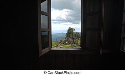 Camera Moves to Open Window Shows Landscape with Cliff