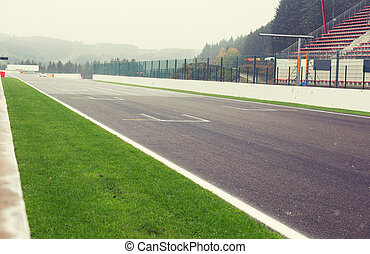 close up of speedway track or road and stands - motosports,...