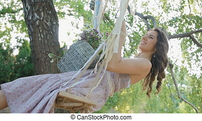 Young woman teeter in the shadow of the tree - Young...