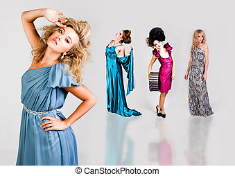 Young Women Modeling Elegant Fashions - Attractive young...