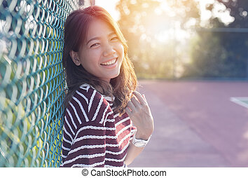 beautiful asian younger woman laughing with happiness...