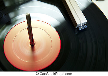 turntable is spining and the music is playing
