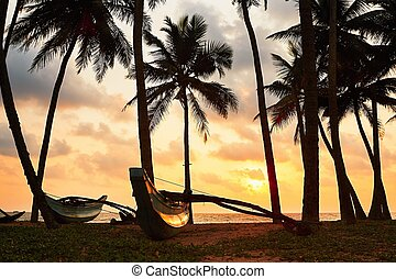 Tropical island at the sunset - Silhouette of the fishing...
