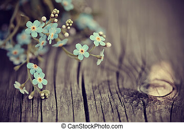 Forget-me-nots on a wooden table - Blue forget-me-nots lie...