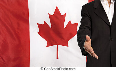 Open hand and Canada flag in the background - Businessman...