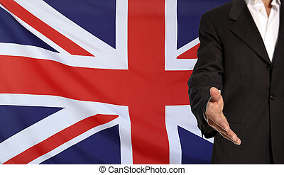 Open hand and Great Britain flag in the background -...