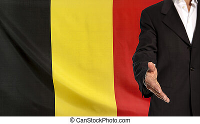 Open hand and Belgium flag in the background - Businessman...