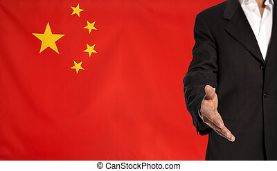 Open hand and China flag in the background - Businessman...
