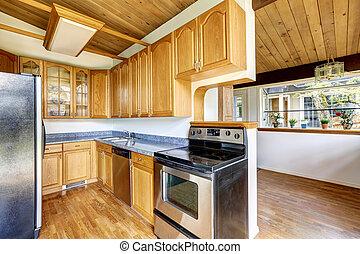 cocina, con, madera dura, piso, y, granito, mostrador, cima,...