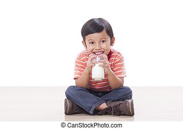 Cute boy drinking milk
