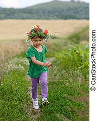 Running little happy girl meadow weat field