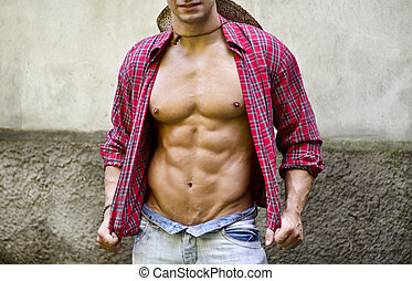Torso of muscular young man with open shirt - Torso of...