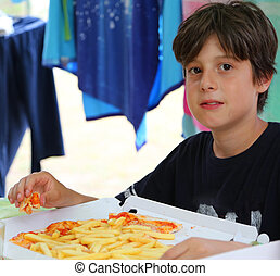 hungry kid eats pizza with mozzarella cheese and fries -...