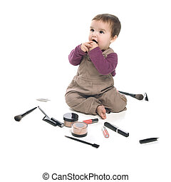Baby girl with cosmetics - Baby girl playing with cosmetics,...