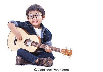 Cute boy playing the ukulele on white background