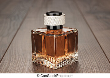 perfume bottle on the table - perfume bottle on the brown...