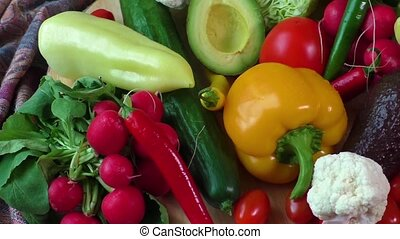 Pile of organic vegetables on a wooden table