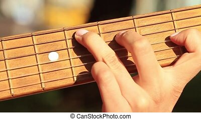Plaing guitar in sunny morning. HD