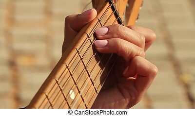 Playing guitar in sunny morning. HD