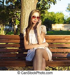 Beautiful emotional brunette girl laughing on the phone in...